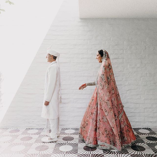 It was 115 degrees on Yogita & Hitesh's wedding day and I don't think there's anyone else who could have pulled it off as gracefully as them.. (biggest troopers of 2018!!!) In order to avoid the heat and being seen before the ceremony, we decided to do the first look at the back entrance of the Gene Autry suite and it was better than anything we could have hoped for :') #kapsuleweddings — Venue: @parkerpalmsprings  Photo/Video: @kapsuleco Planning: @cojweddings
