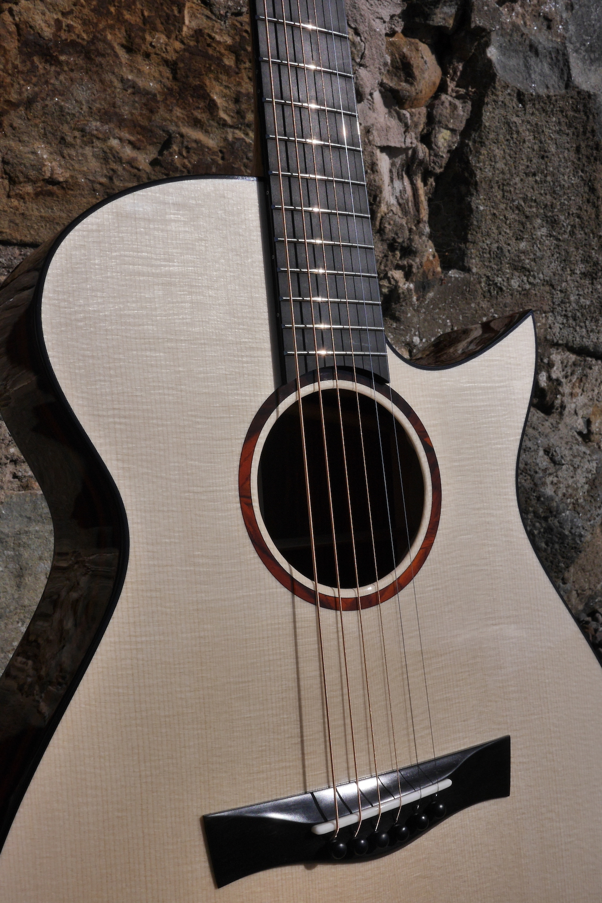 Melamine Lacquer lets the grain shin beautifully and the guitar sing naturally