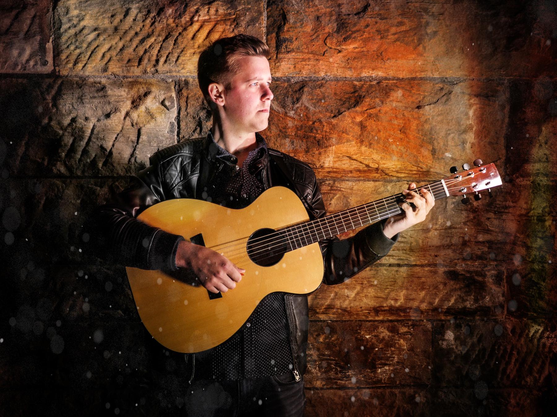 Graeme at the Taran Guitars workshop with his new guitar