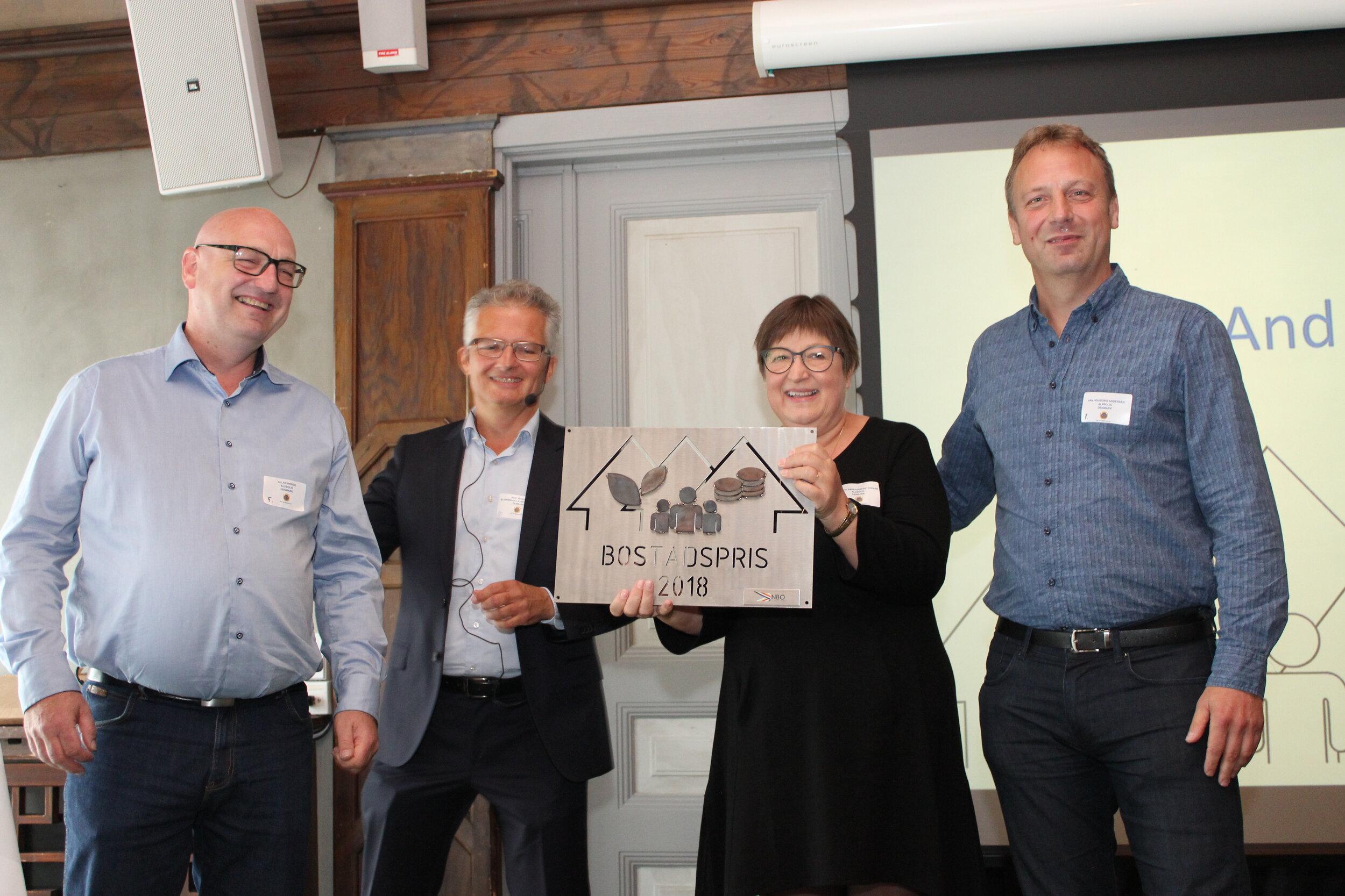 This years winner of Bostadsprisen - Langkærparken from Al2bolig in Tilst, Denmark. From right Allan Werge CEO, (Bent Madsen chairman of NBO), Anette Østerhaab Chairman, and Jan Houborg Andersen Head of the social program, in Al2bolig.