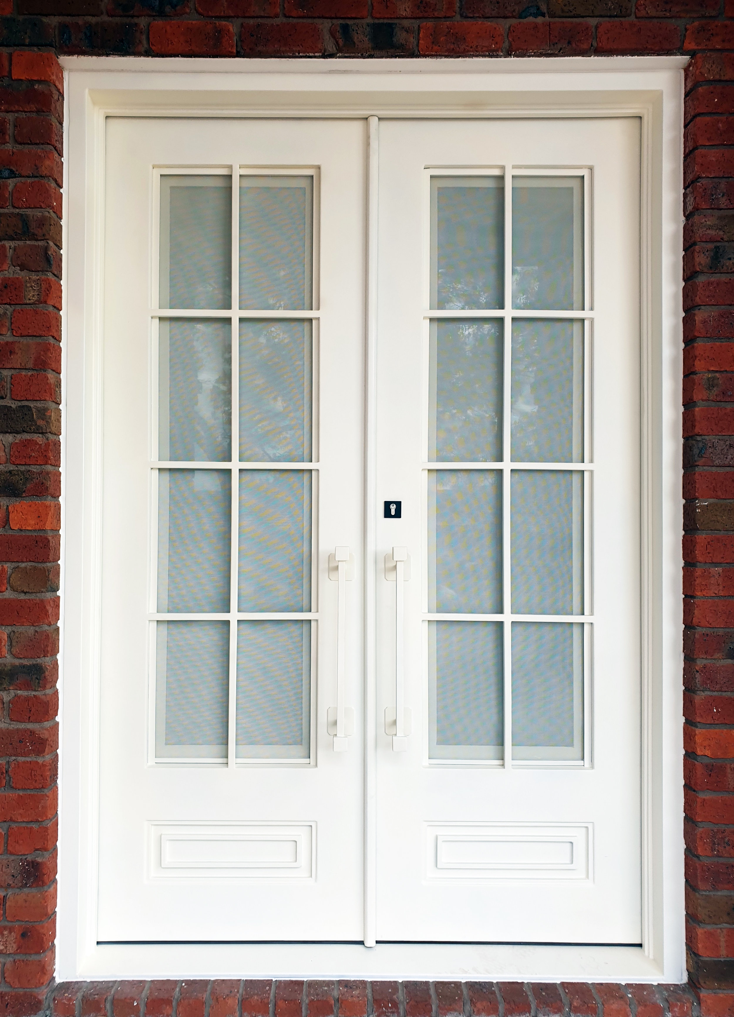 white wrought iron door!