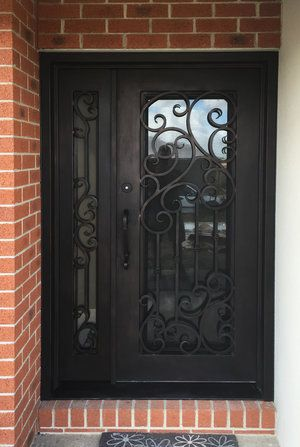 wrought iron mother and son door