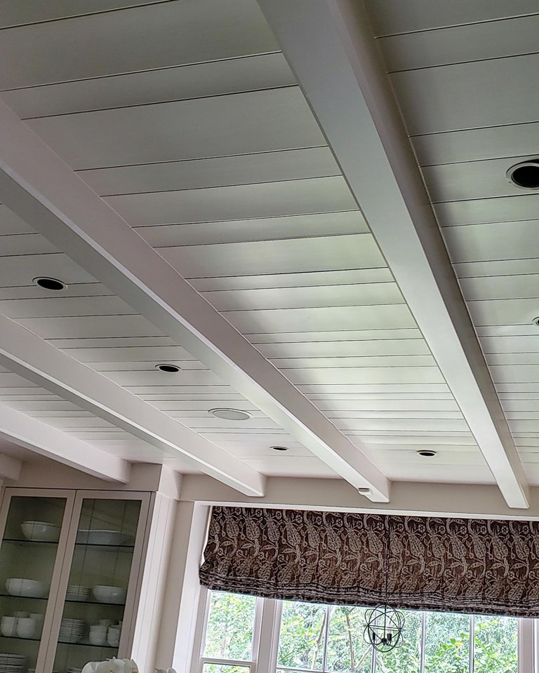 These ceiling boards were fine when they were stained but curled when painted. This is a dissipation plane that had been historically performing but the paint was not specified to allow for it to maintain the original vapor drive principles. We will correct it though.