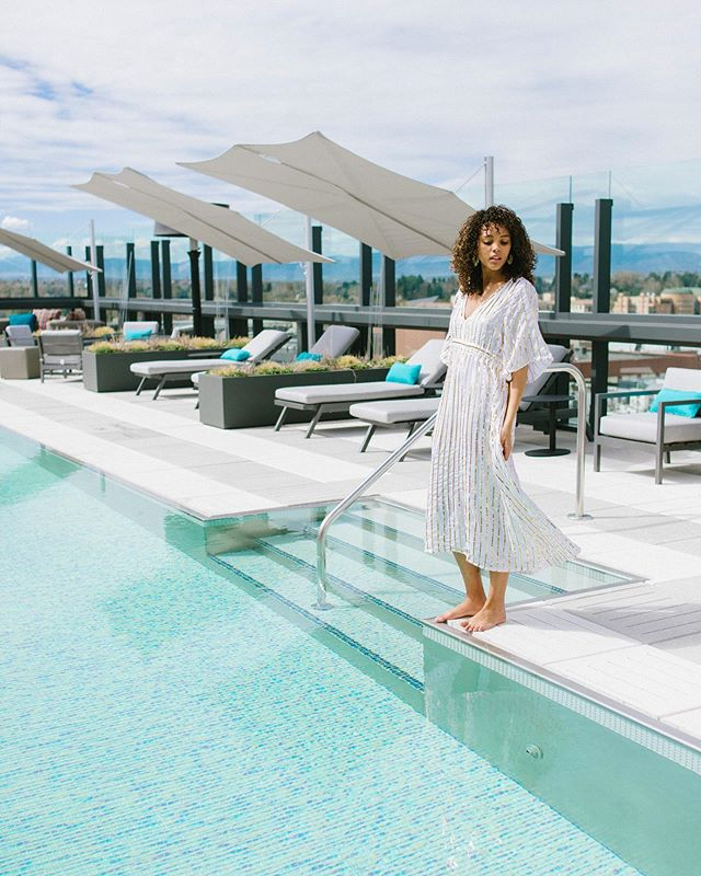 Brb never leaving the @thejacquard rooftop pool 👓 Wearing: the gold sequin @sundress_official Carolina coverup. ✨