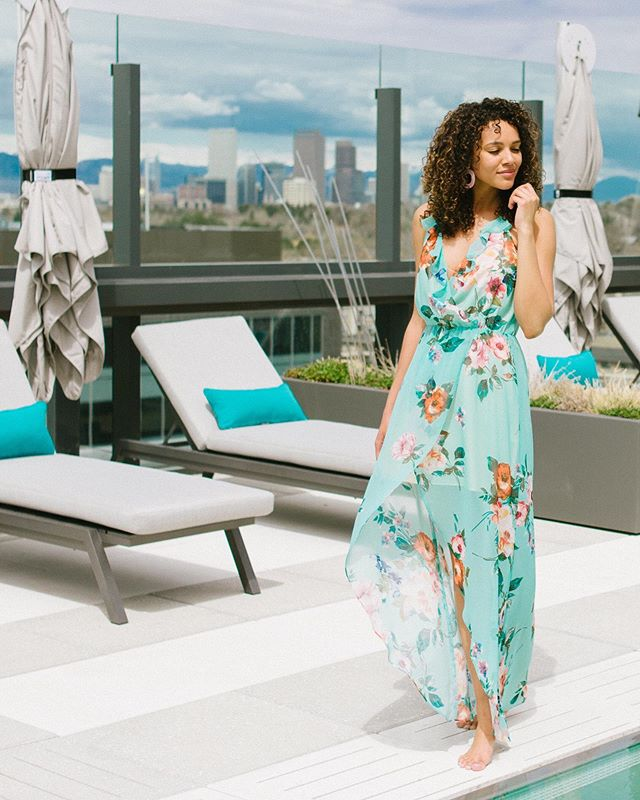 Turn heads in this stunning shade of teal. This maxi dress will keep you cool in a light, breezy fabric and make you the talk of the party in a summery floral pattern🌸☀️