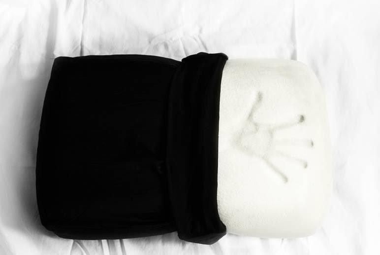 The Night Pillow  offers a dense yet inviting and head cradling memory foam that supports your neck and spine.