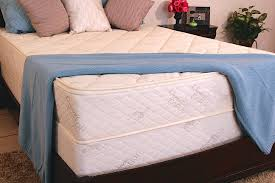 The  USBoxspring Solid Wood Foundation , shown beneath the mattress above, is finished with an organic quilted covering that is easily installed.