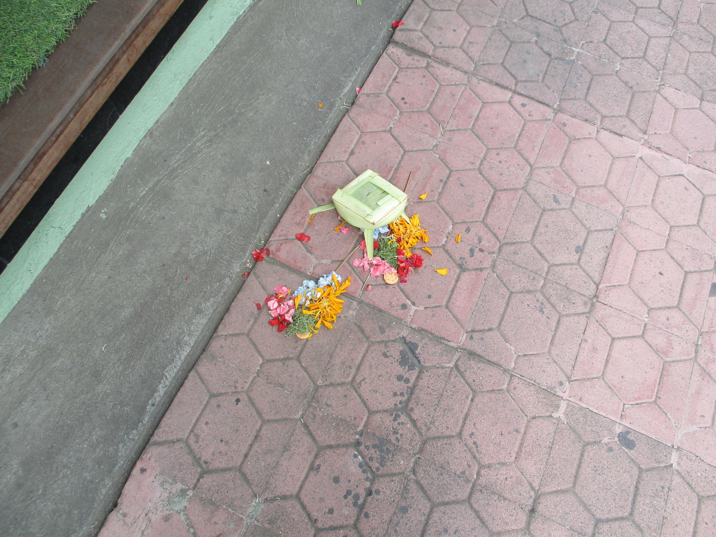Canang (prayer offerings) on the pavement