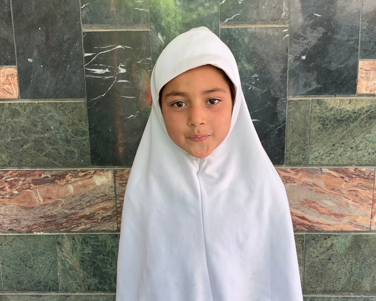 Fatima A., Age 8 - Fatima has 6 siblings. Her mother sews (she's a graduate of Sozo's Women's Training Program!). Her father is a driver.BE FATIMA A'S PARTNER >