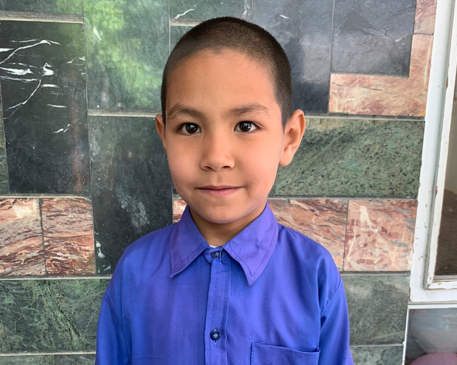 Qaimai, Age 7 - Qaimai has 6 siblings. His mother is a graduate of the beadwork program at the Sozo Training Center. His father is unemployed.BE QAIMAI'S PARTNER>