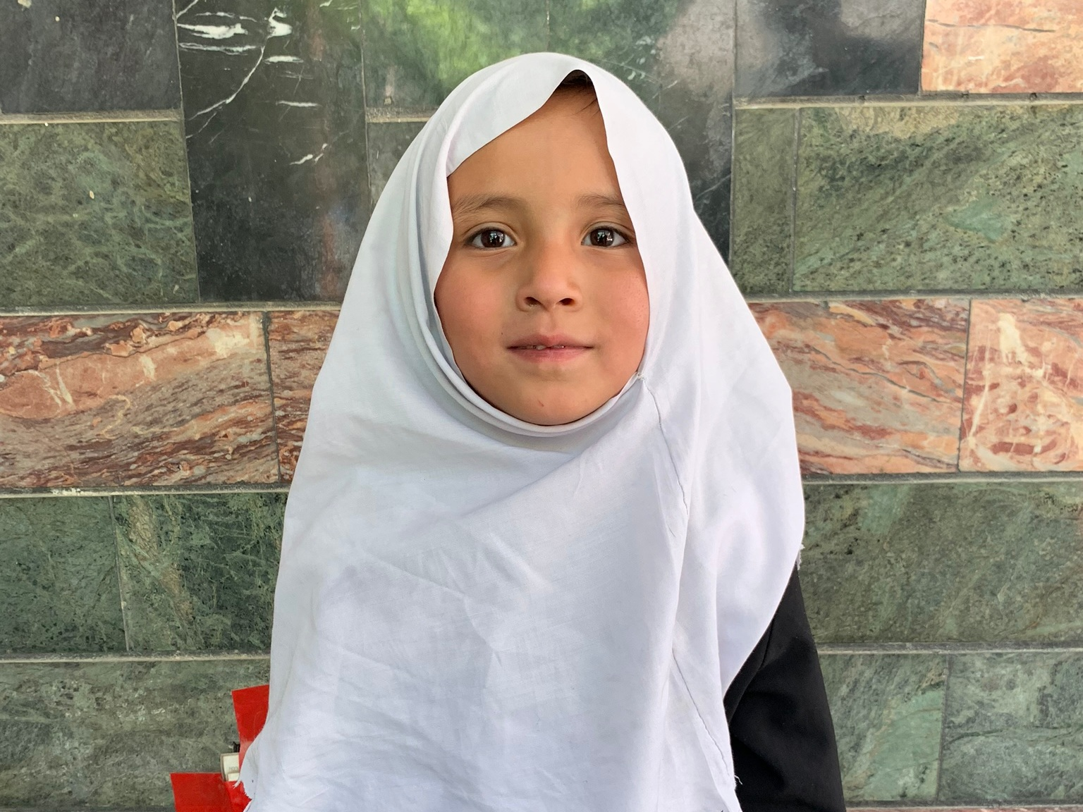 Sadiqa, Age 6 - Sadiqa has 6 siblings. Her Mother is enrolled in the Sewing class at the Sozo Training Center. Her Father is a Shop Keeper.BE SADIQA'S PARTNER >