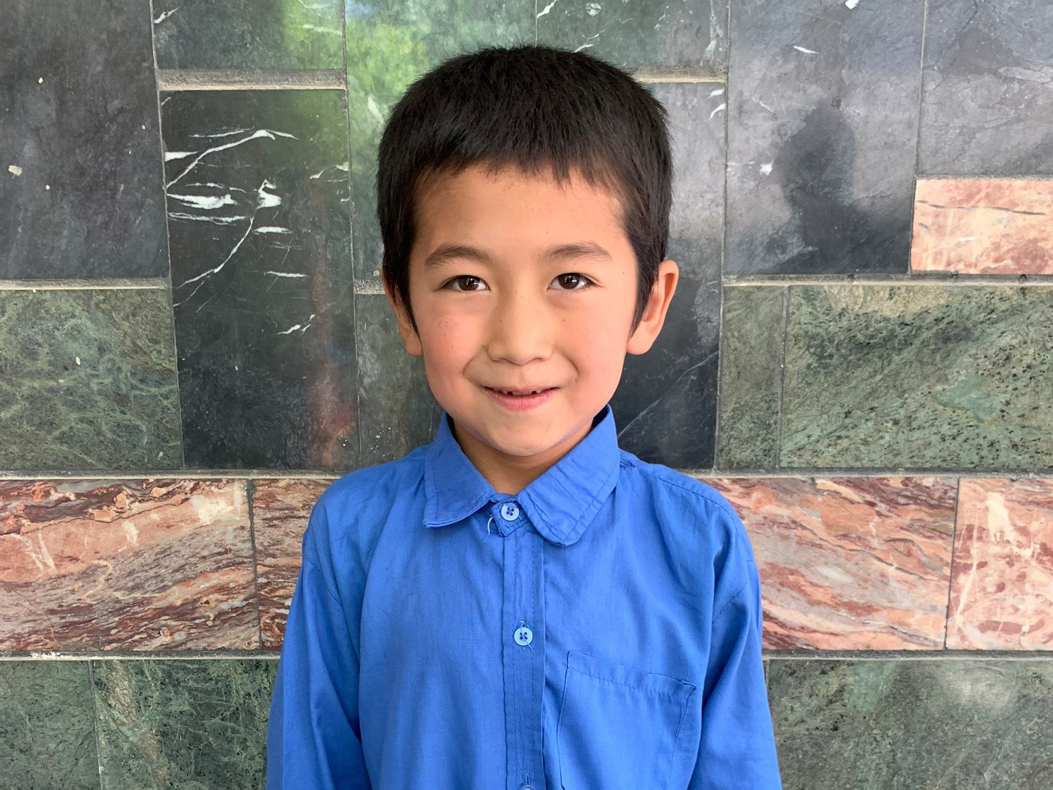Ali, Age 8 - Ali has 6 siblings. His mother does not have work. His father works at a bath house.BE ALI'S PARTNER>