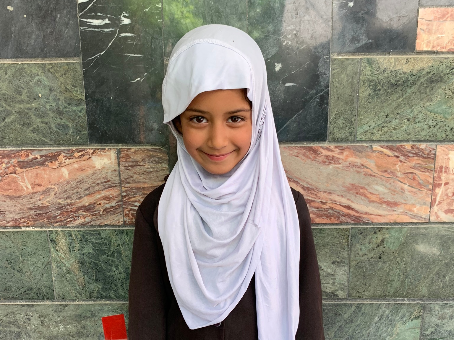 Asma B., Age 7 - Asma has 3 siblings. Her mother does not have work at this time. Her father is a shopkeeper.BE ASMA B'S PARTNER>