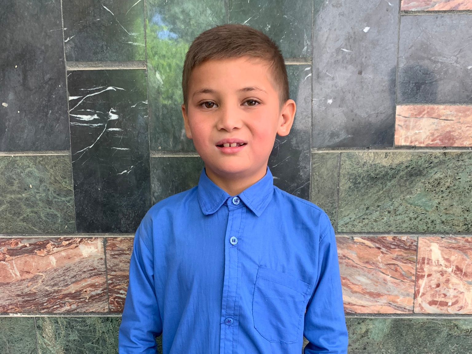 Ali Komil, Age 8 - Ali Komil has 2 siblings. His mother is without work at this time. His father sells plastic.BE ALI KOMIL'S PARTNER>