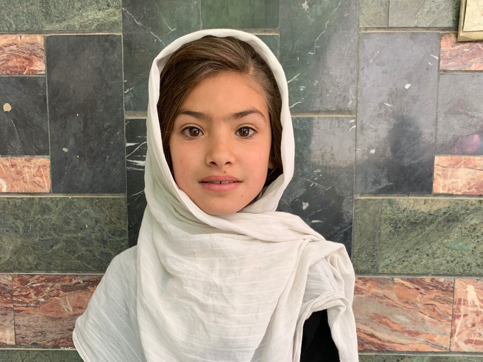 Madina, Age 9 - Madina has 5 siblings. Her mother is a tailor. Her father does not have work at this time.BE MADINA'S PARTNER>
