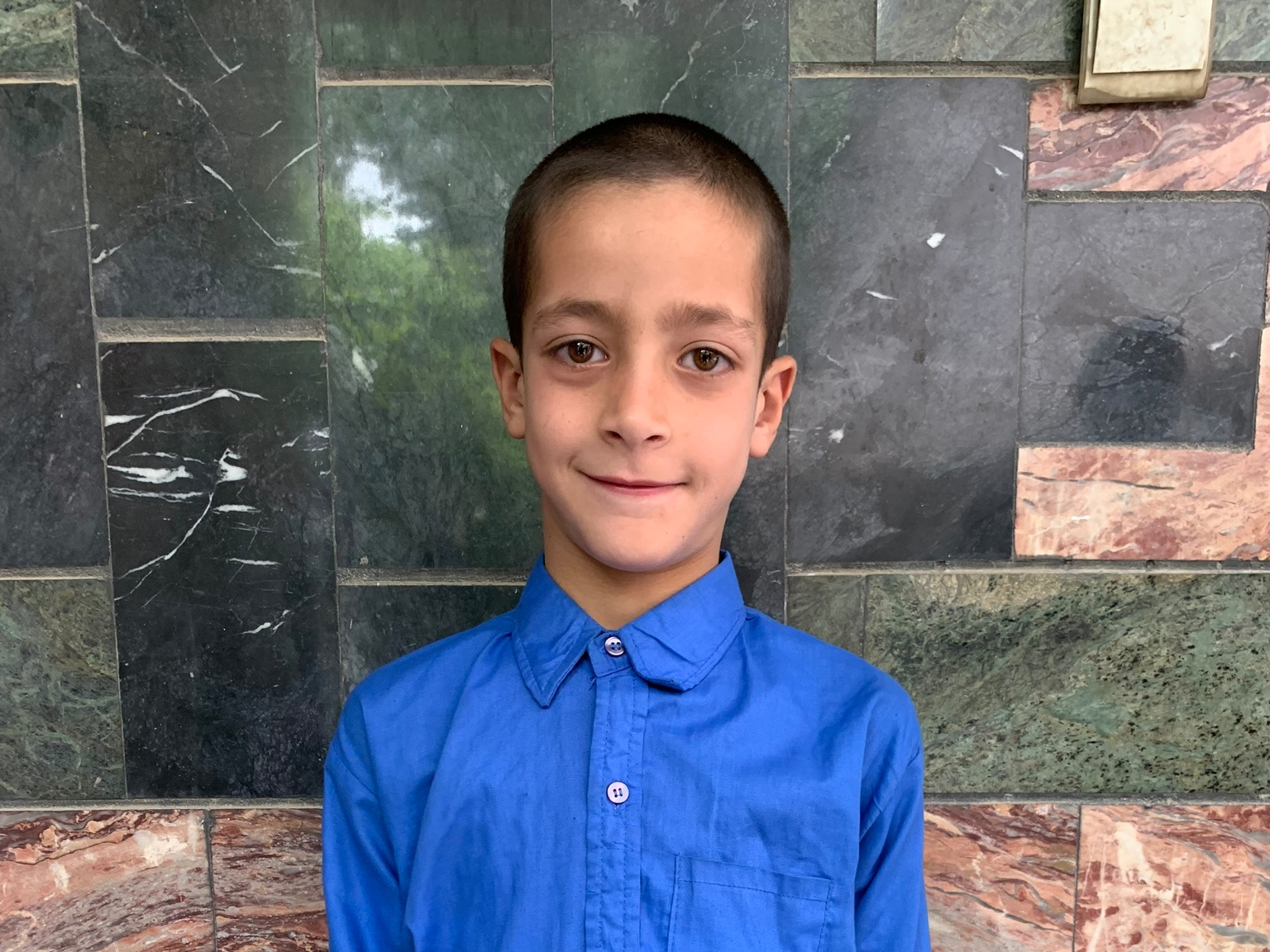 Amir Hossein, Age 8 - Amir Hossein has 3 siblings. His mother does not have work at this time. His father does bicycle repair.BE AMIR HOSSEIN'S PARTNER>