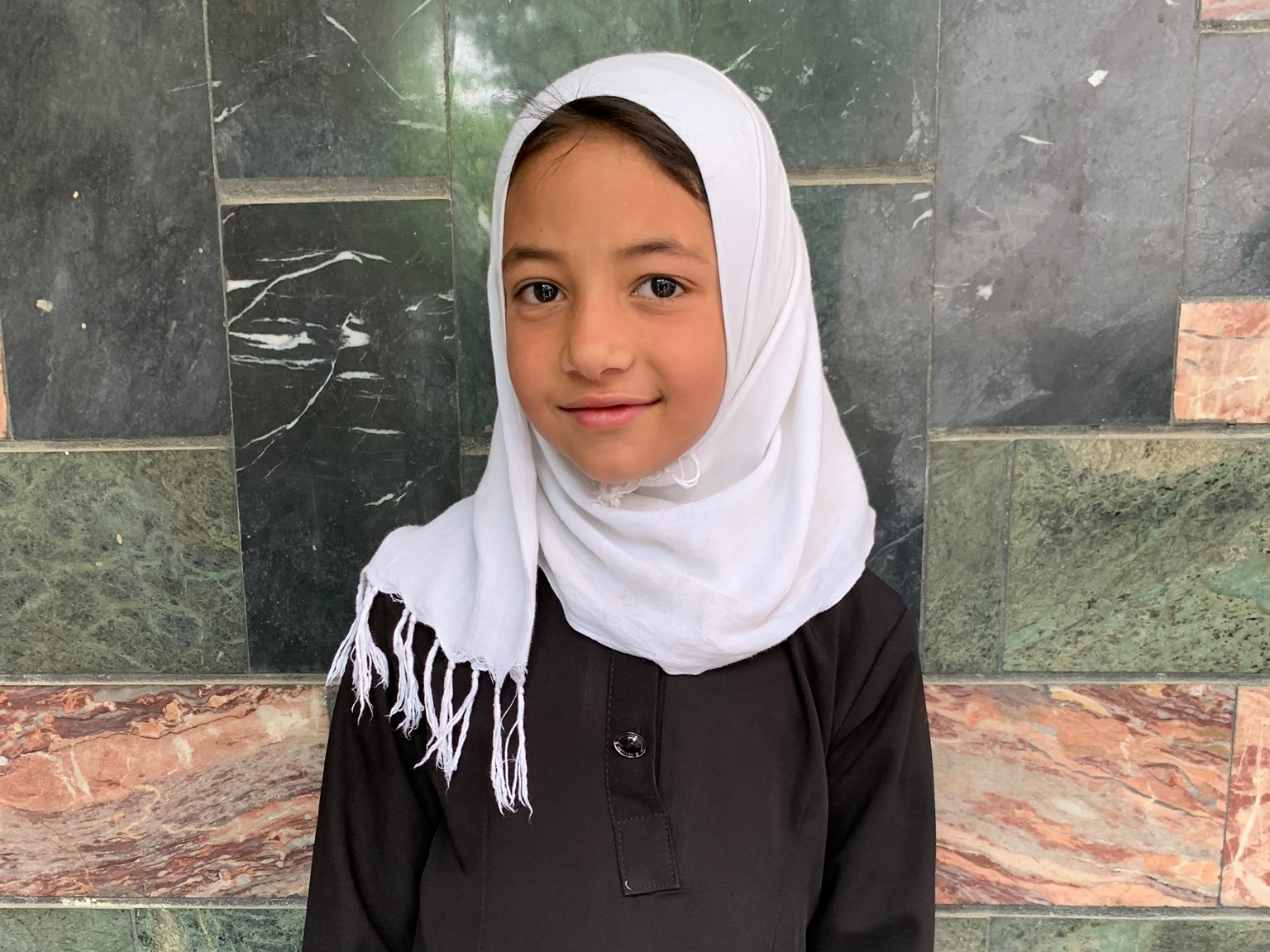 Frozan, Age 9 - Frozan has 5 siblings. Her mother does not have work at this time and her father sells phone cards.BE FROZAN'S PARTNER>