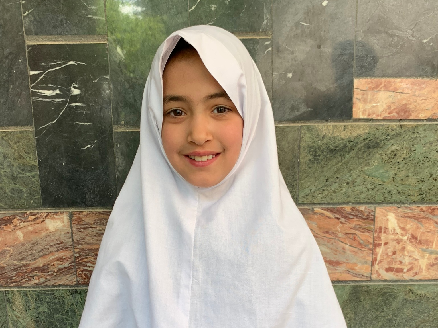 Zahra, Age 8 - Zahra has 2 siblings. Her mother does not have work at this time. Her father is a driver.BE ZAHRA'S PARTNER>