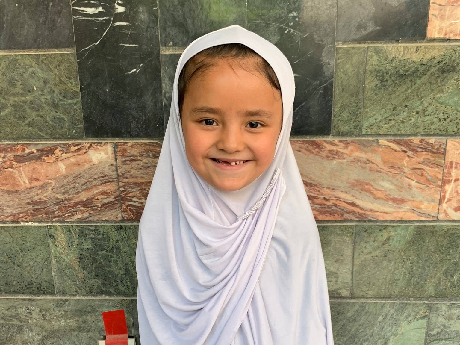Madina, Age 7 - Madina has 5 siblings. Her mother is unemployed and her father is a driver.BE MADINA'S PARTNER>∆