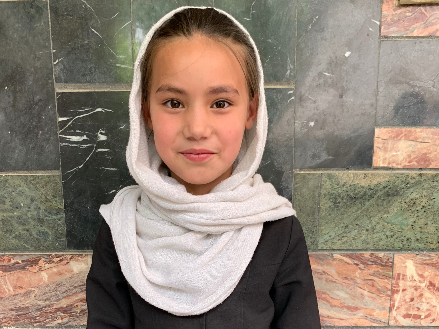 Muzhada, Age 9 - Muzhda has 5 siblings. Her mother is unemployed and her father is a construction worker.BE MUZHADA'S PARTNER>