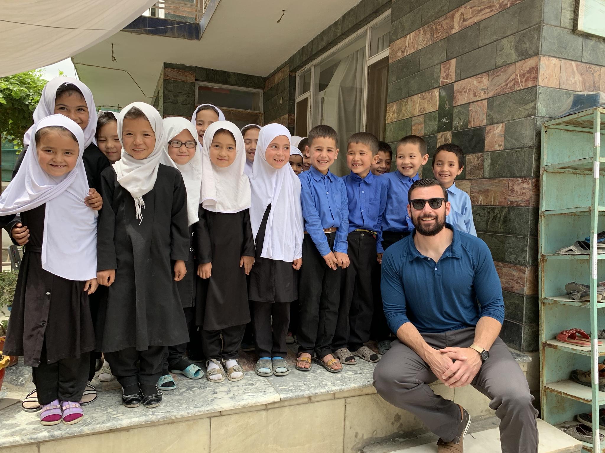 Seth Gardner of Sozo International with sweet Sozo school students.