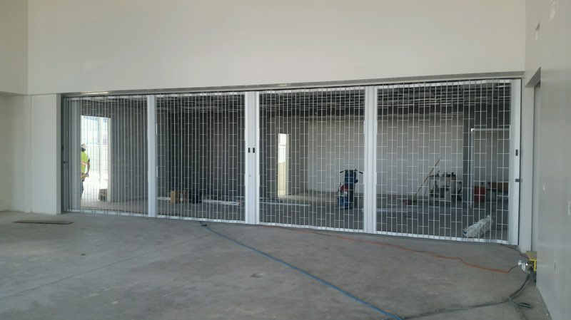 Sliding Grilles - Sliding Grilles are ideal for separating spaces while maintaining visability. Sliding Grilles open by folding, similar to an accordion.