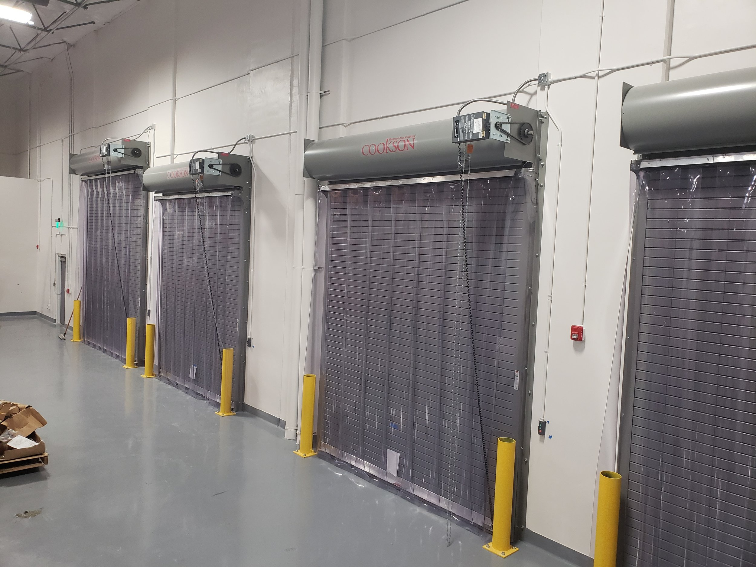 Strip Doors - Strip doors are ideal in reducing energy costs, separating workplaces, and streamlining workflow. Unlike standard steel or metal doors, strip doors allow people, objects, and machinery to easily move through the plastic strips without physically opening any doors.