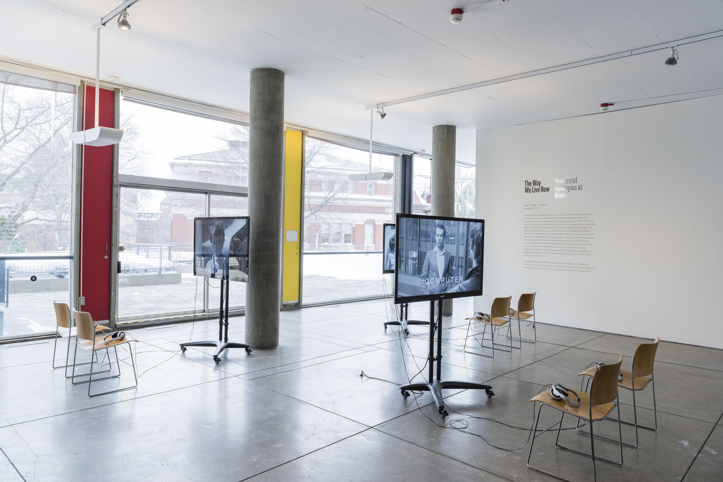 Gerard Byrne,  Subject , 2009. Installation view. Three-channel video shown on monitors and vinyl wall text. 27 × 32 feet. Commissioned by the Henry Moore Institute, Leeds, England. Courtesy the artist and Green on Red Gallery, Dublin.