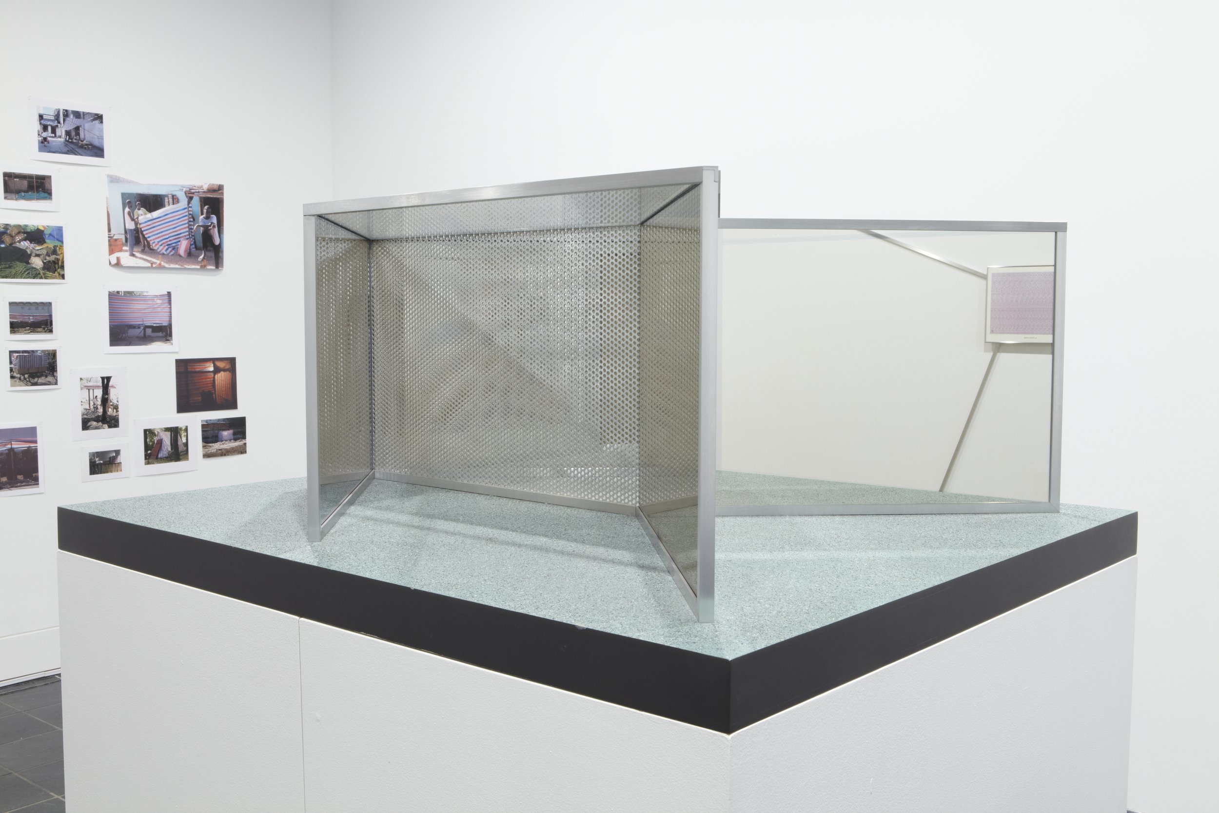 Dan Graham,  Serpentine II , 1995. Two-way mirror, transparent glass, punched aluminum, aluminum, 14 x 36 x 30 inches. Courtesy of Marian Goodman Gallery, New York