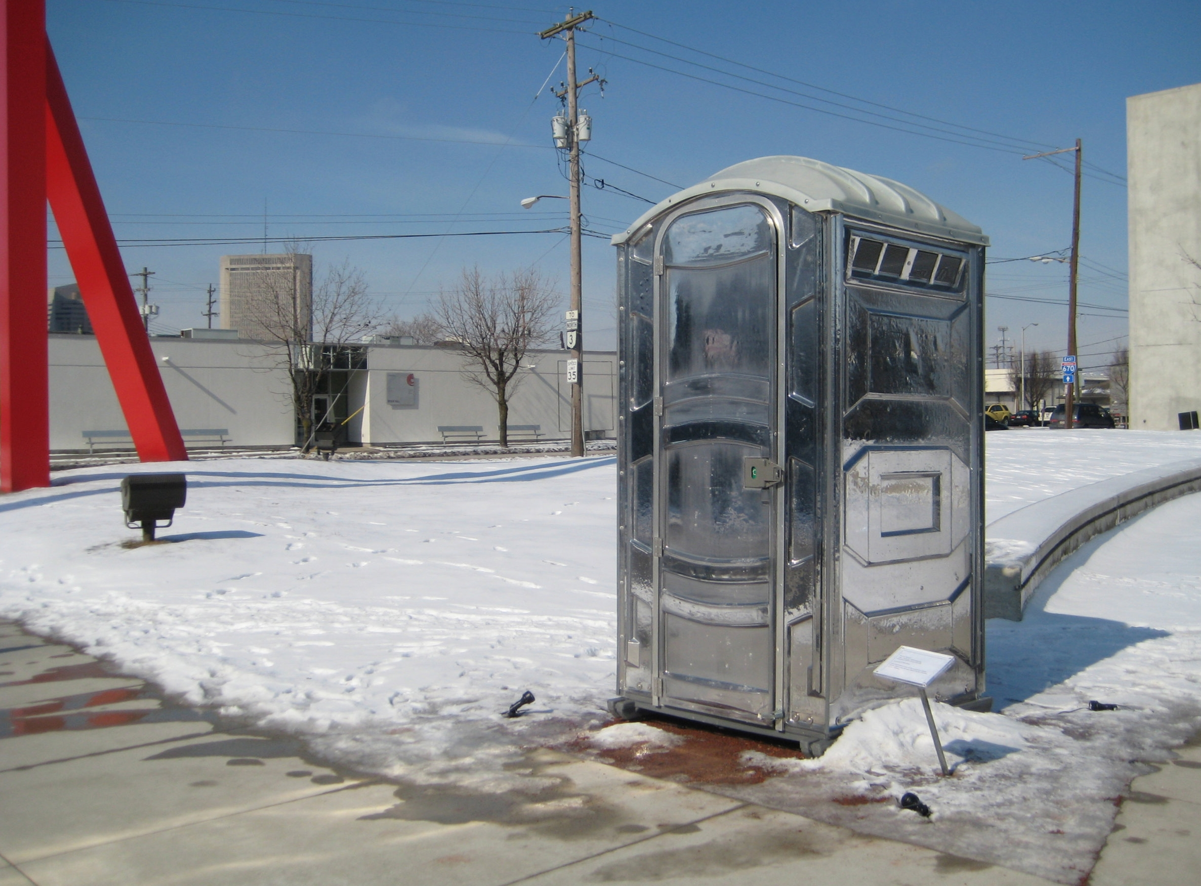 Patrick Killoran,  Glass Outhouse , 2002-ongoing;unlimited edition of port-a-potty, 91 x 43.5 x 47 inches;courtesy of the artist
