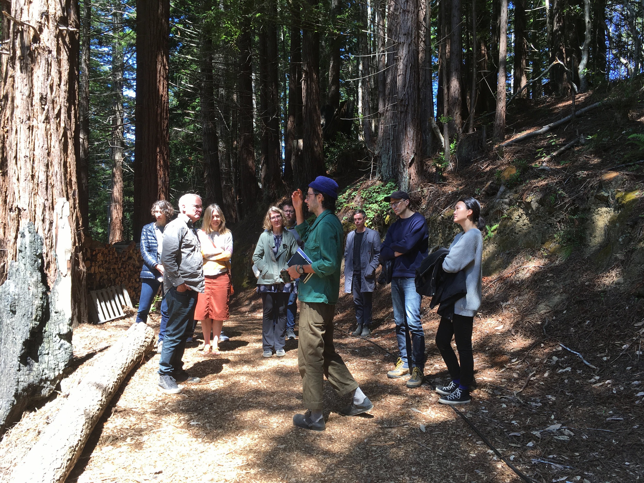 Calvin Rocchio provides a tour of grounds at Salmon Creek, visiting several cabins sited across the land, June 8, 2018.