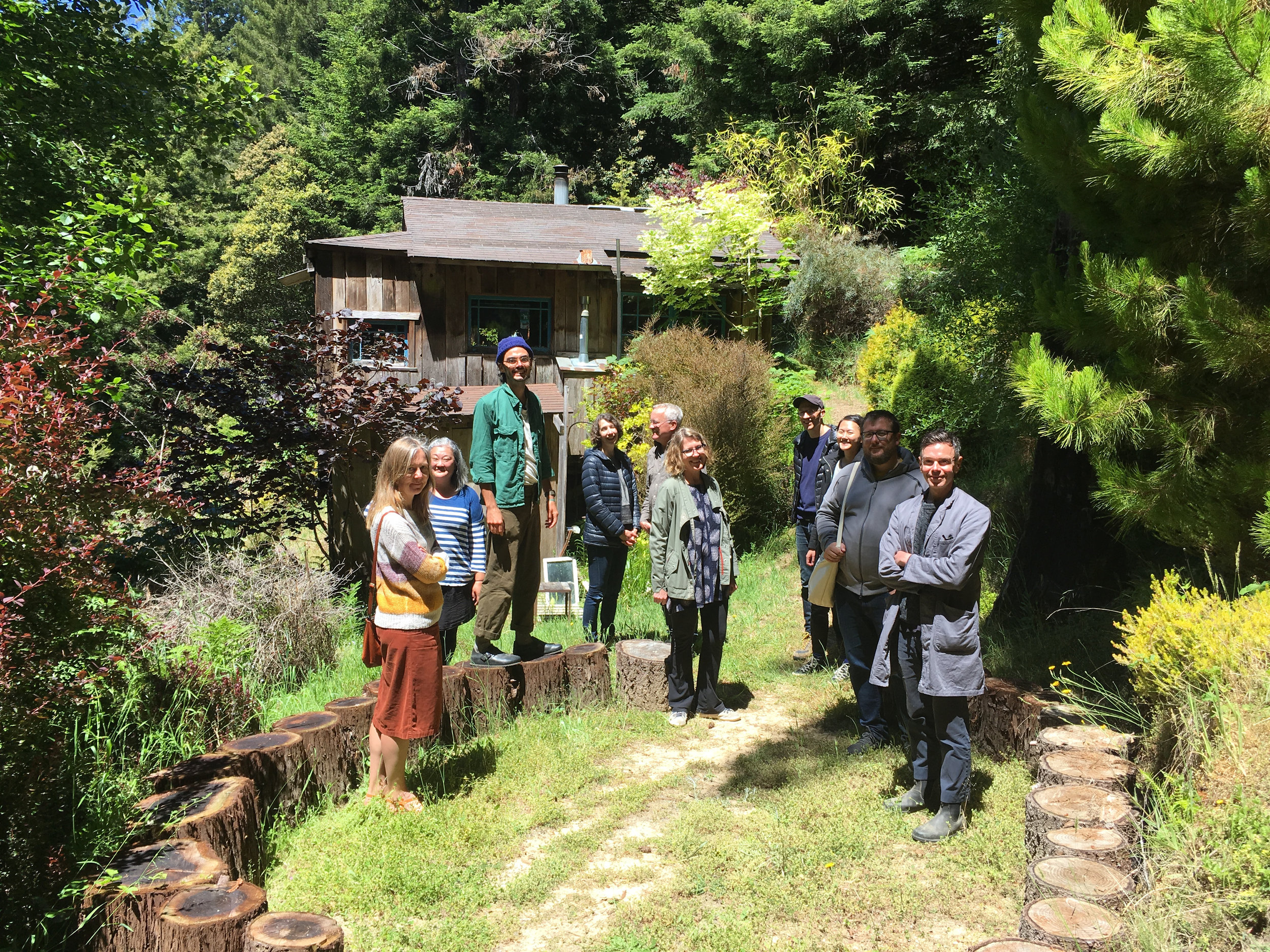 The crew of  Companion Planting during a walk around the land, June 8, 2018