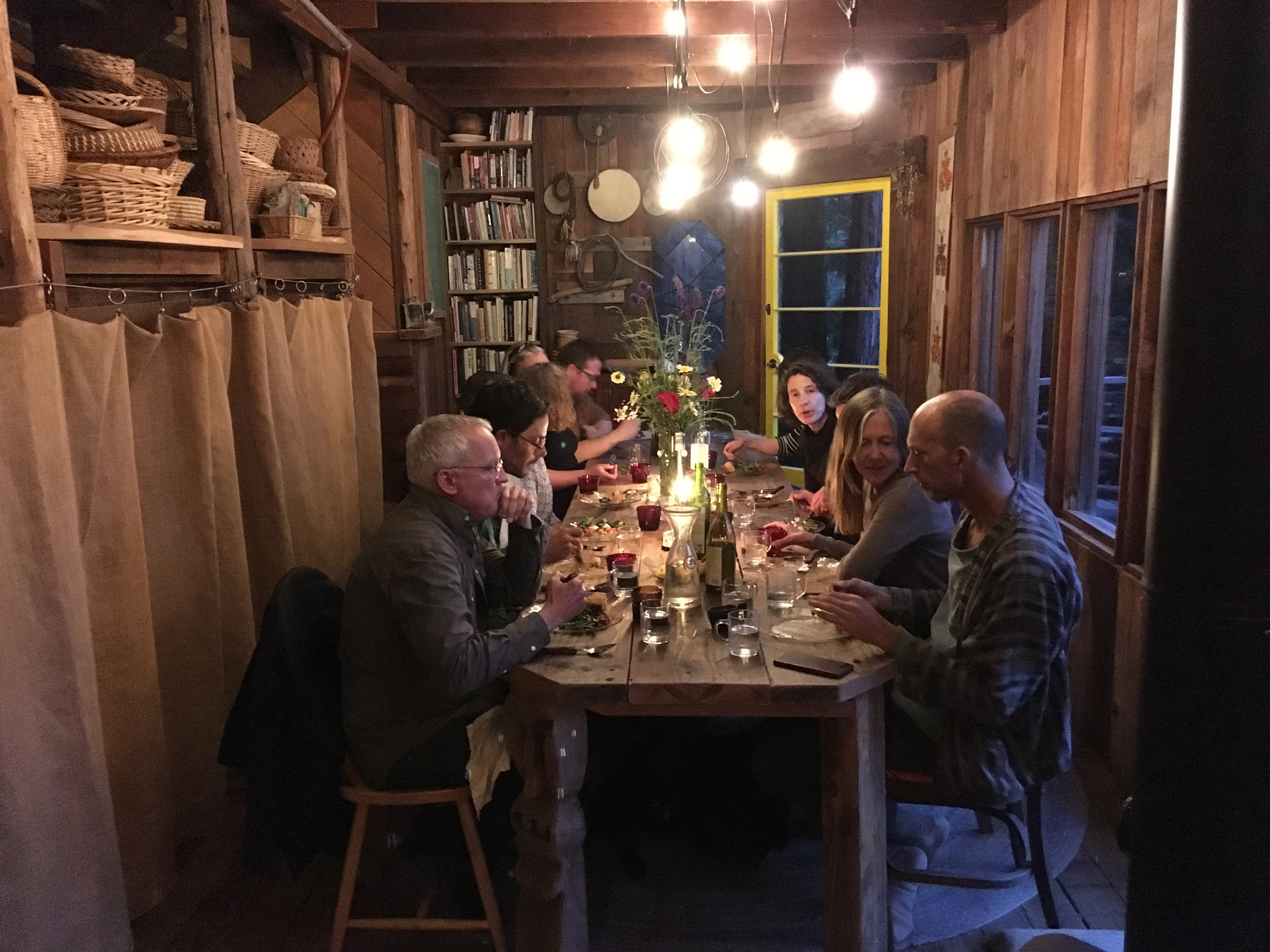Dinner with participants and Fritz Haeg in Dawn Cabin, the communal locus of Salmon Creek Farm, June 8, 2018.