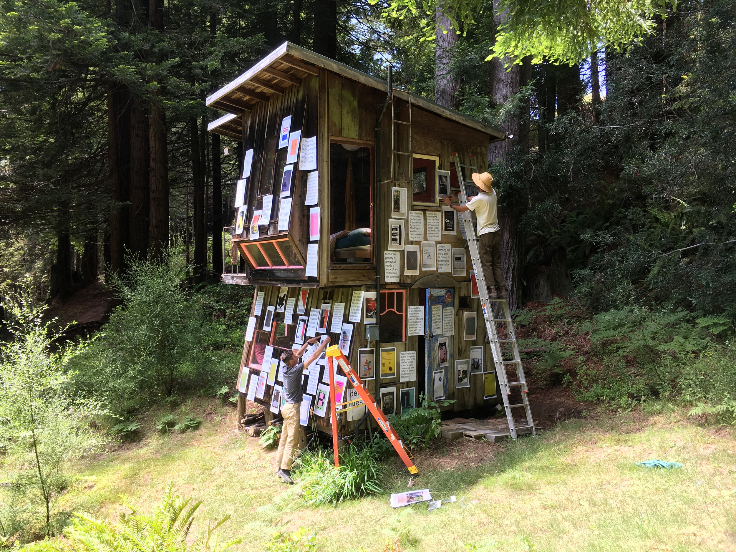 Companion Planting . Module: Institutions, led by Nate Padavick, Calvin, Rocchio, and James Voorhies. Installation of posters of photographs of books and related quotes reflecting modes of visionary challenges to institution practice. River Cabin, Salmon Creek Farm, June 9, 2018.