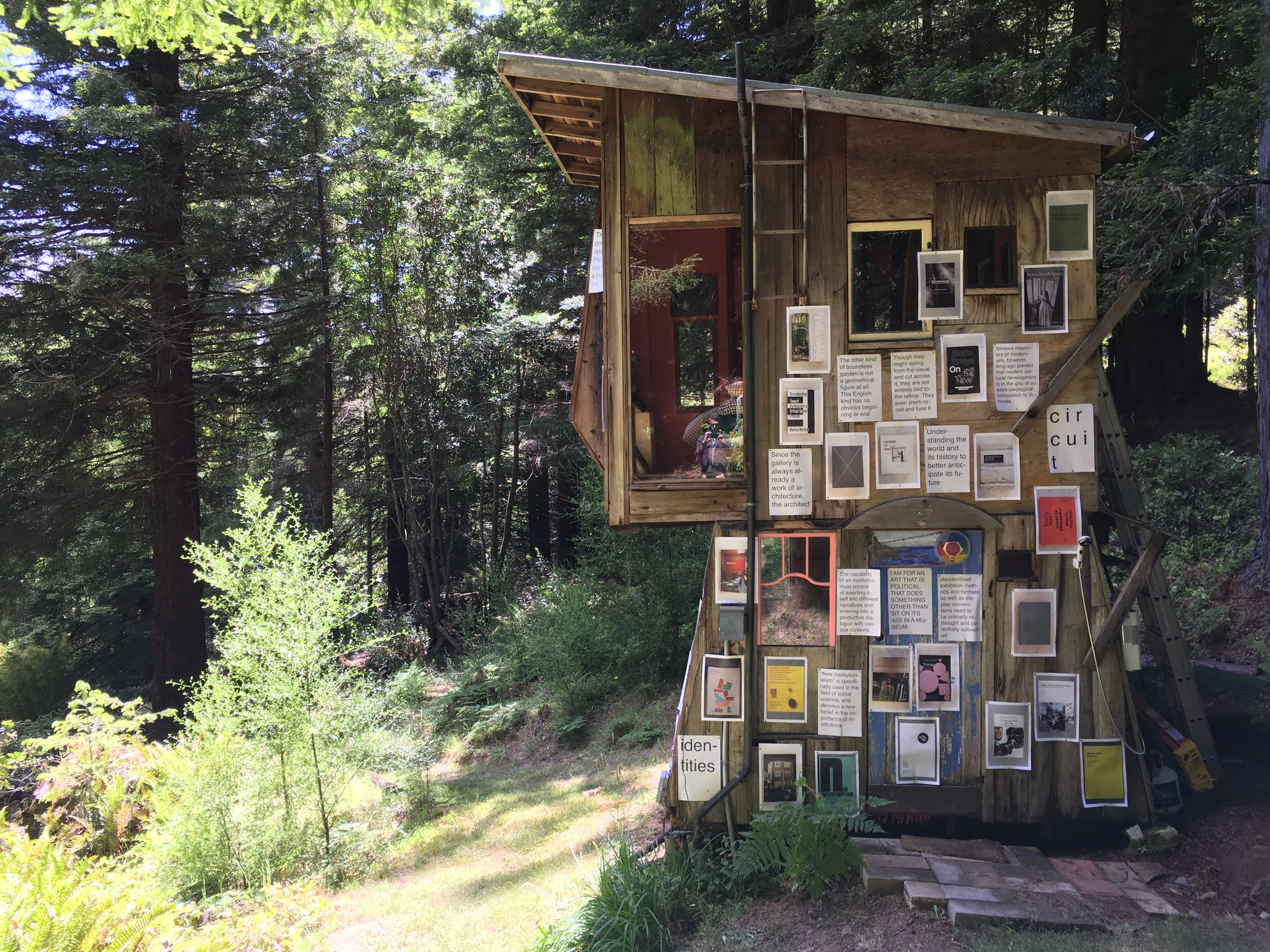 Companion Planting . Module: Institutions, led by Nate Padavick, Calvin, Rocchio, and James Voorhies. Posters of photographs of books and related quotes reflecting modes of visionary challenges to institution practice. River Cabin, Salmon Creek Farm, June 9, 2018.