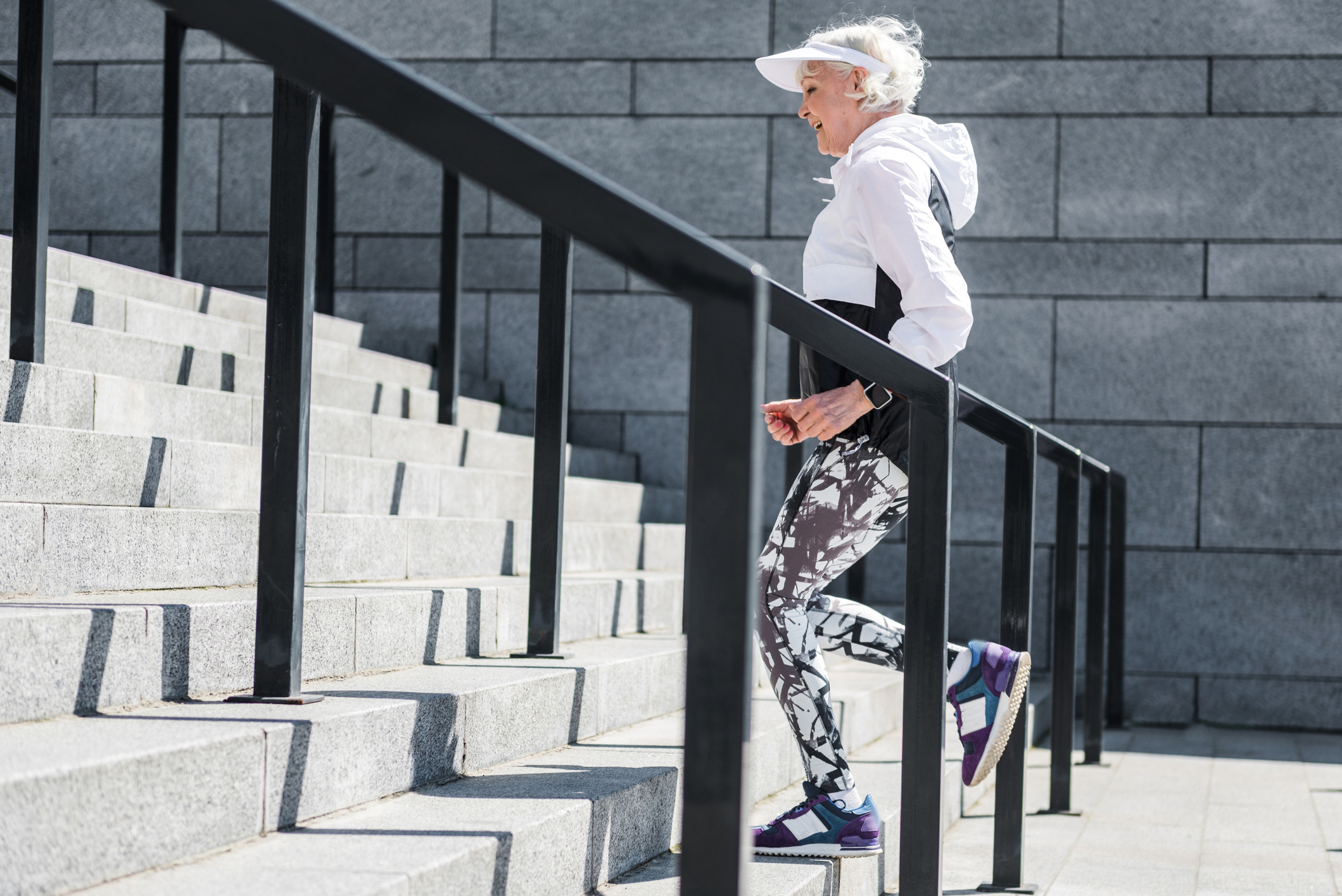 Cheerful-old-lady-training-to-run-up-concrete-stairs-696208932_2123x1417.jpeg
