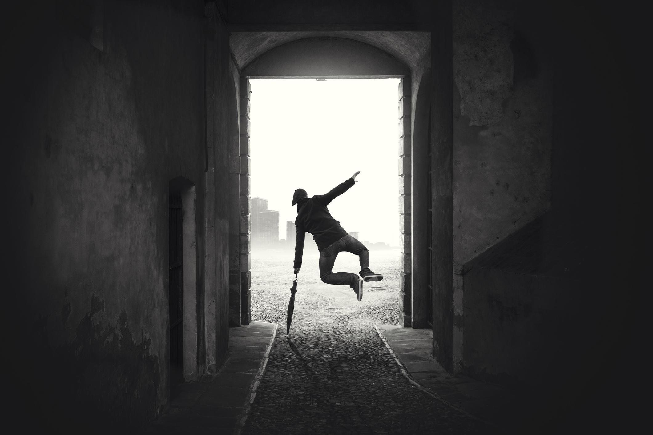 happy-man-jumping-happy-despite-the-bad-weather-865676550_2125x1416.jpeg
