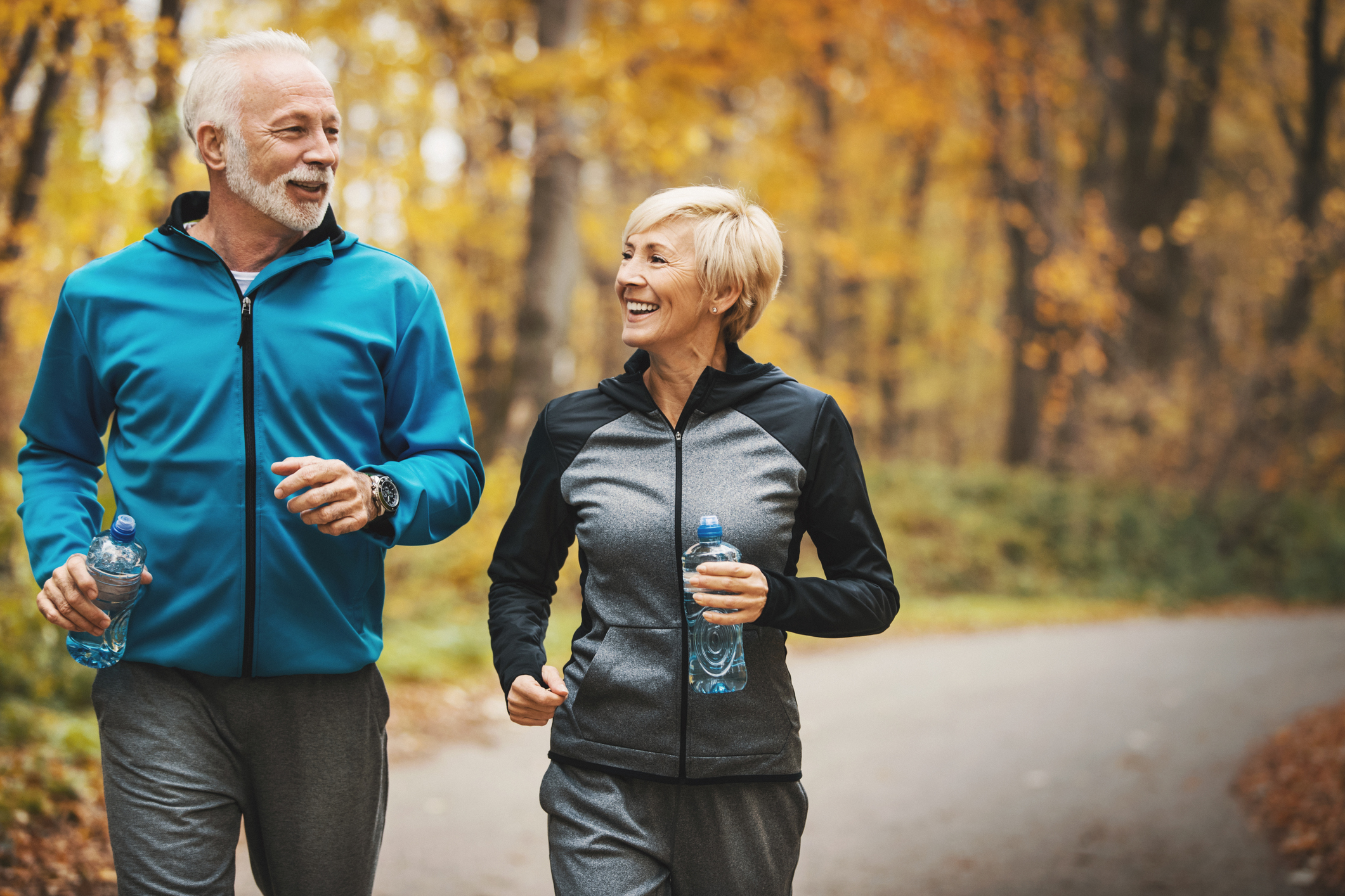 Senior-couple-jogging-in-a-forest.-905501696_2125x1416.jpeg
