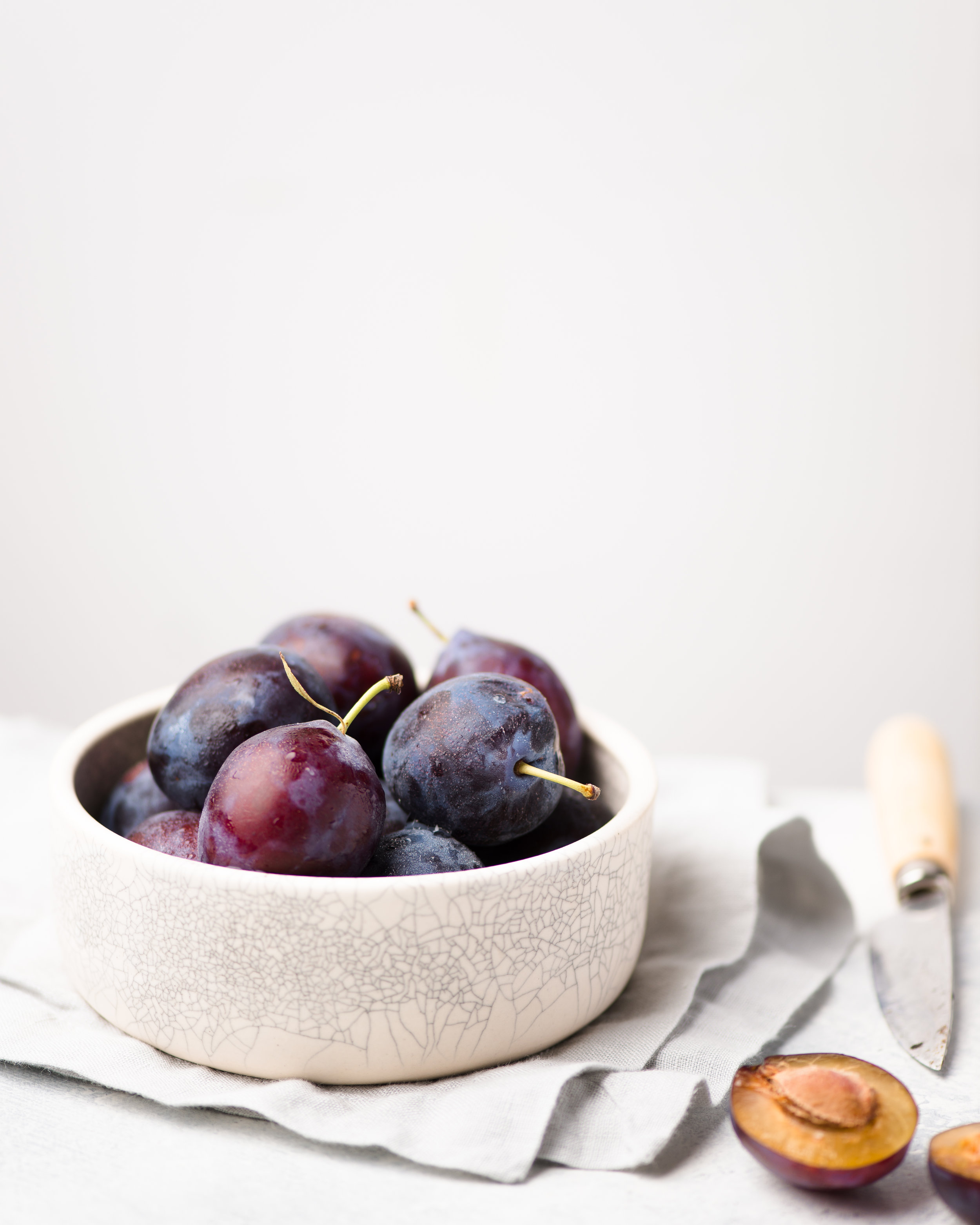 Italian Plums in Ceramic Bowl
