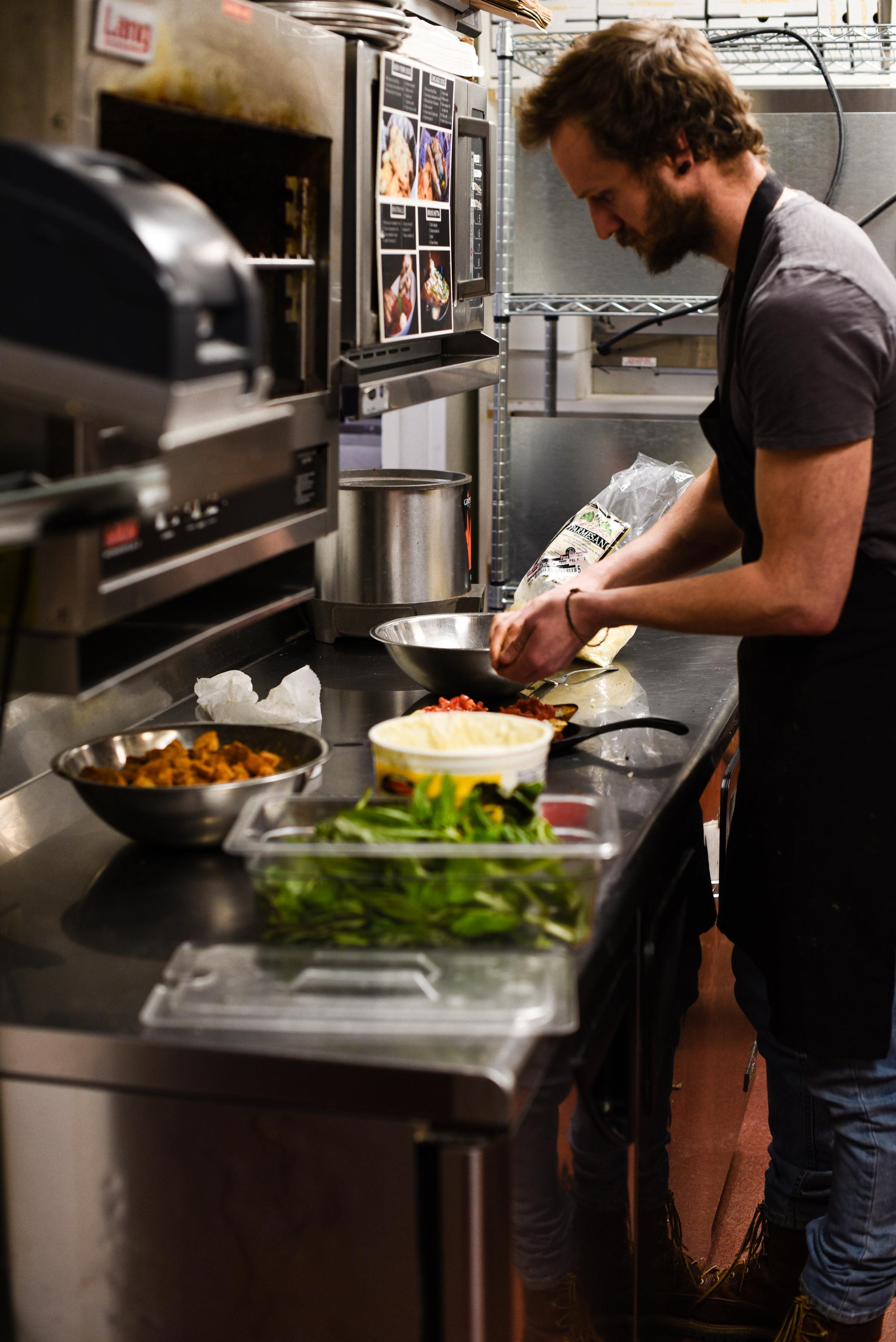 Chef Preparing Dish in Kitchen