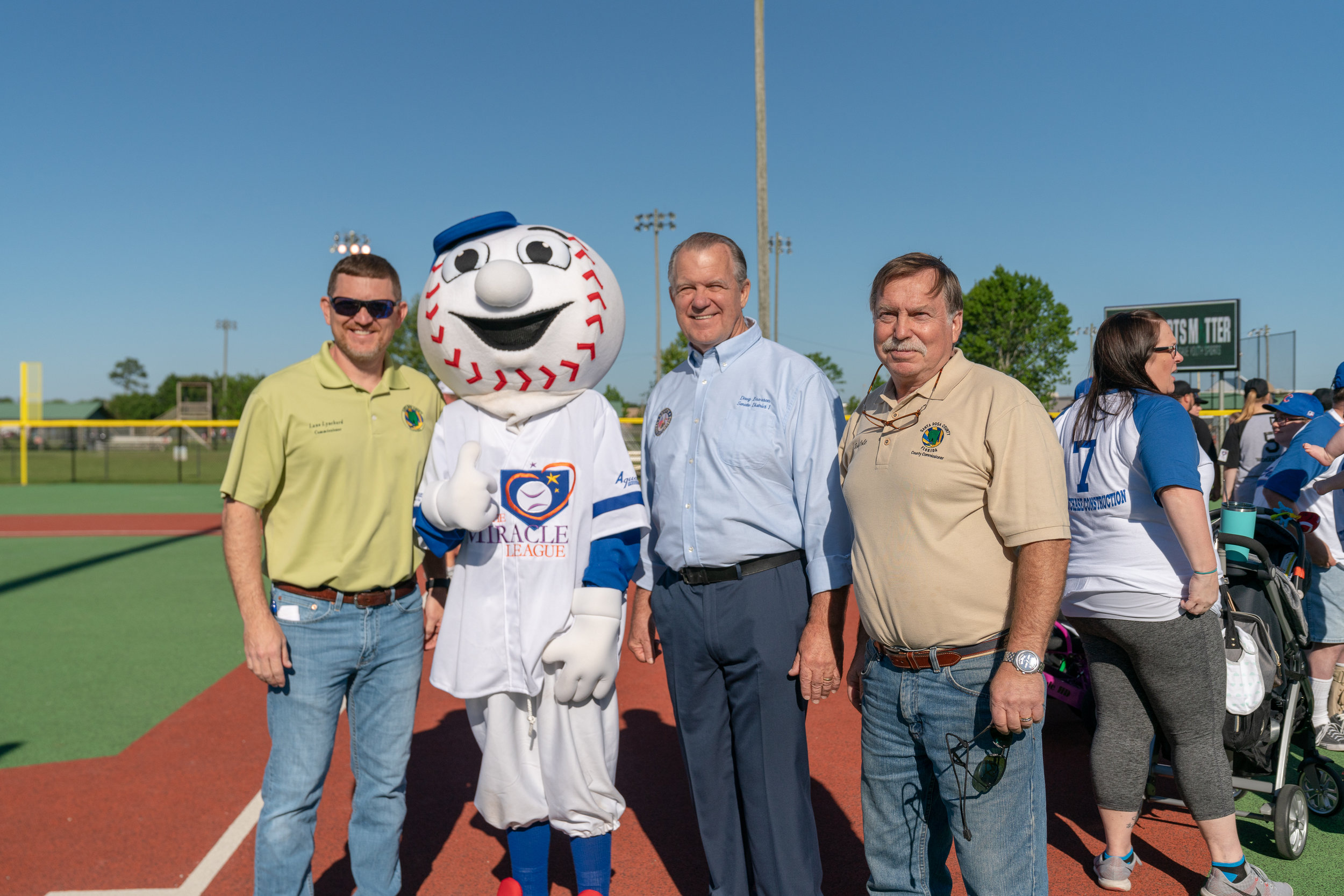 "From Left: Commissioner Lane Lynchard, Homer, Senator Doug Broxson, Commissioner Robert A. ""Bob"" Cole."