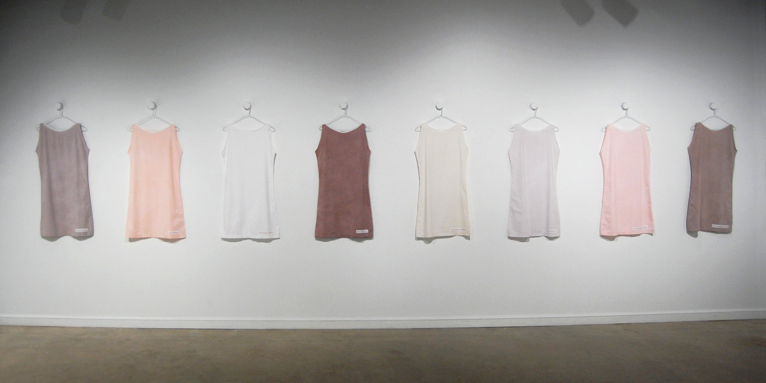 "Figure 1:  Eight Exterior Color Choices for the CountrySide Subdivision  (installation view), dyed cotton, 19""x36"" (individual dresses)"