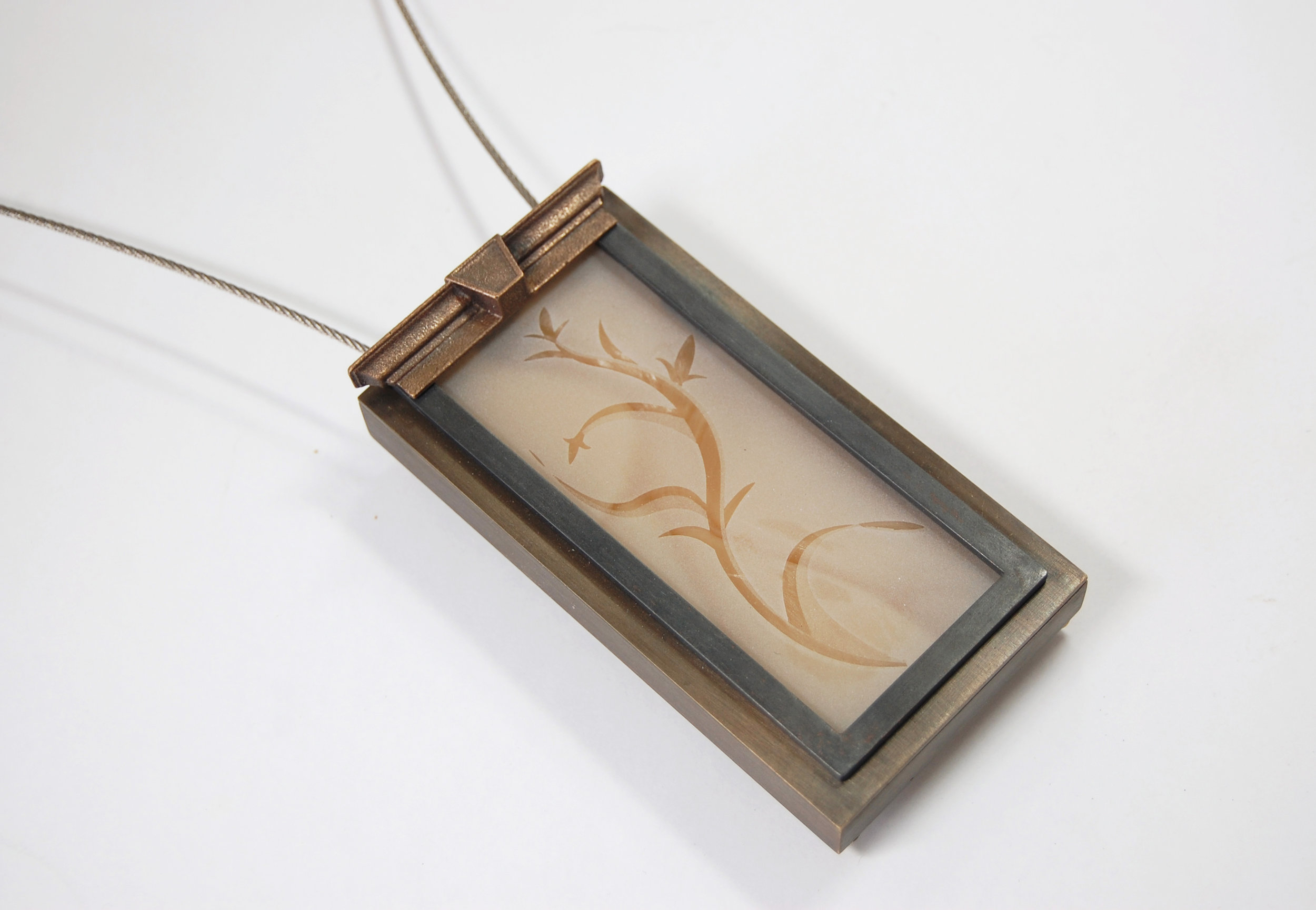 "Figure 13:  Springwood,  cast bronze, nugold, steel cable, glass, silicone, 4 1/8"" x 2 1/8"" x 7/8"""