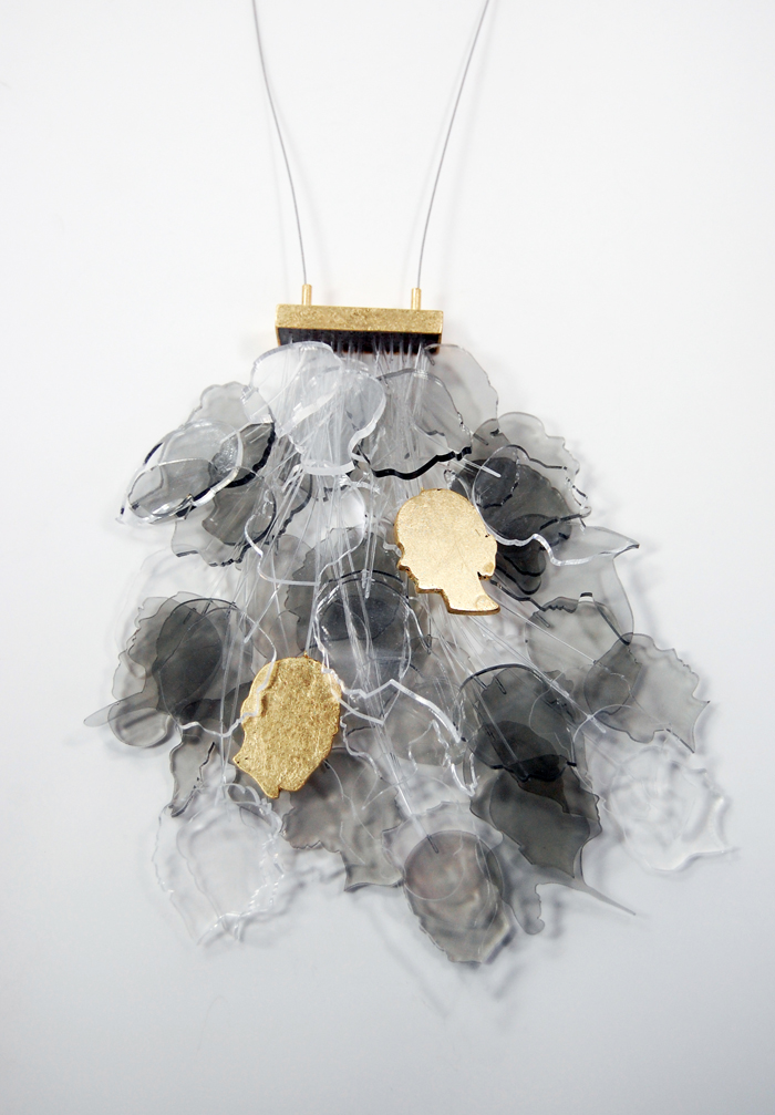 "You and I,  laser cut acrylic sheet, gold leaf, monofilament, brass, steel cable, 6½"" x 3½"" x 1½"", 2012"
