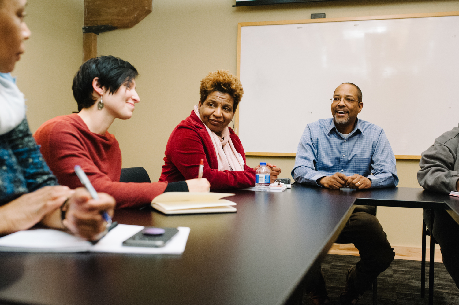Photo of Dave Hall, running for Durham County Judge, sitting at a table with team