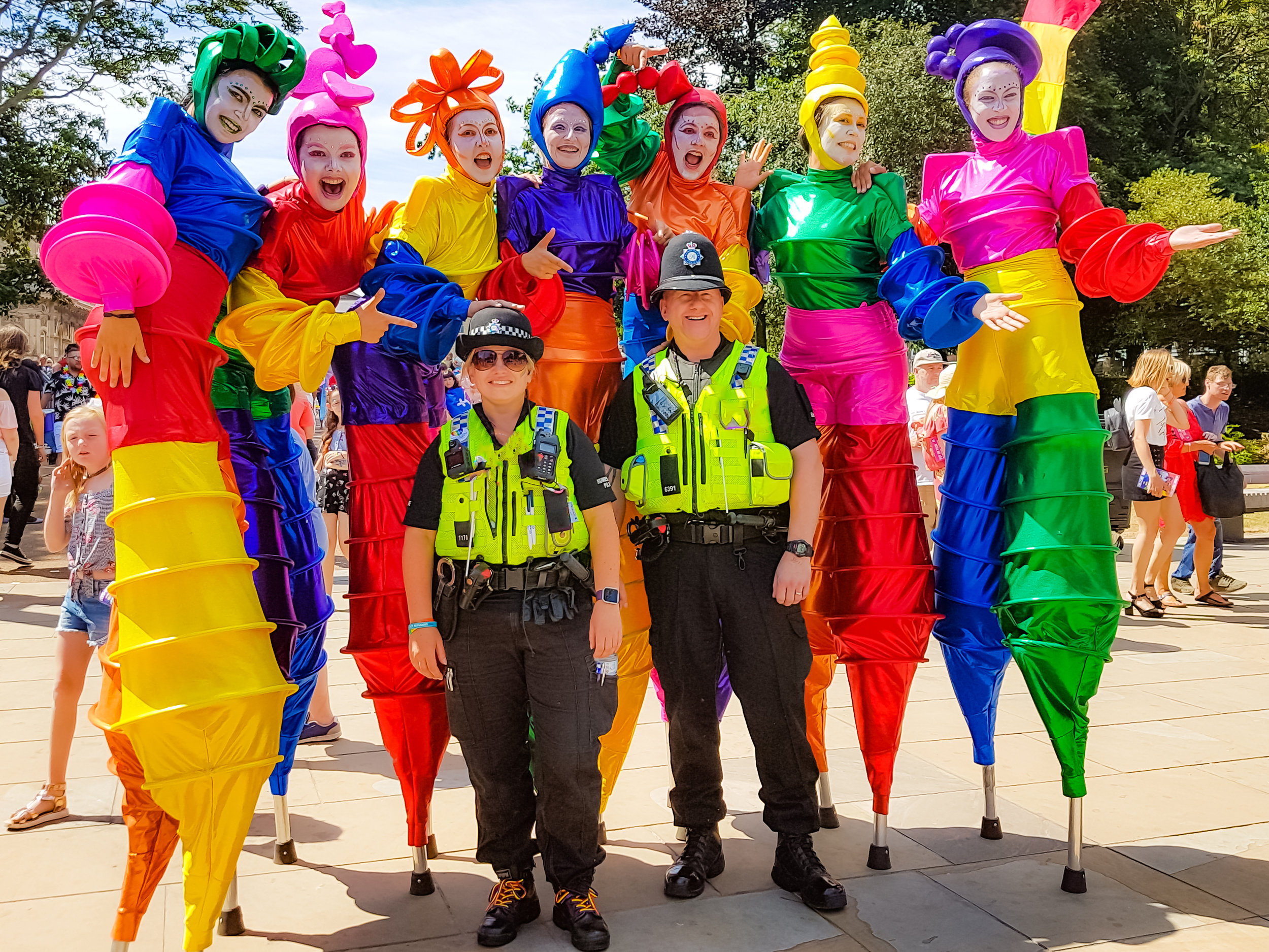 Rainbow_Carnival_Stilt_Dancers_Mixed_Colours_Police.jpg