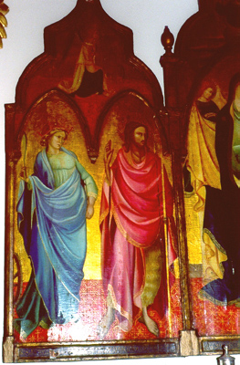 The left panel shows SS. Catherine of Alexandria and John the Baptist. The angel of the Annunciation is above.