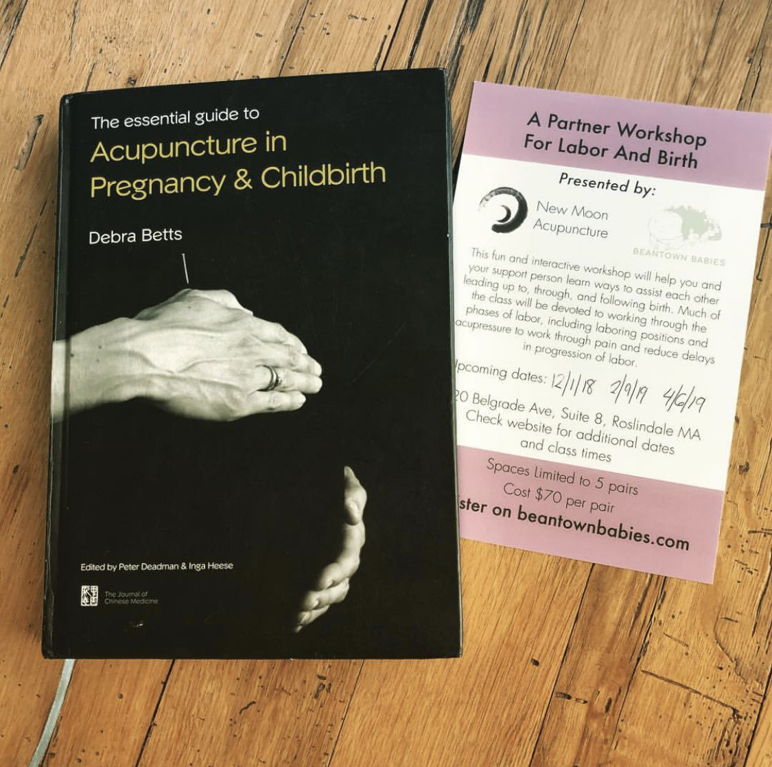 Betts' influential book on acupuncture in pregnancy and birth sits alongside Ece's flyer for upcoming partner workshops at Beantown Babies in Roslindale.