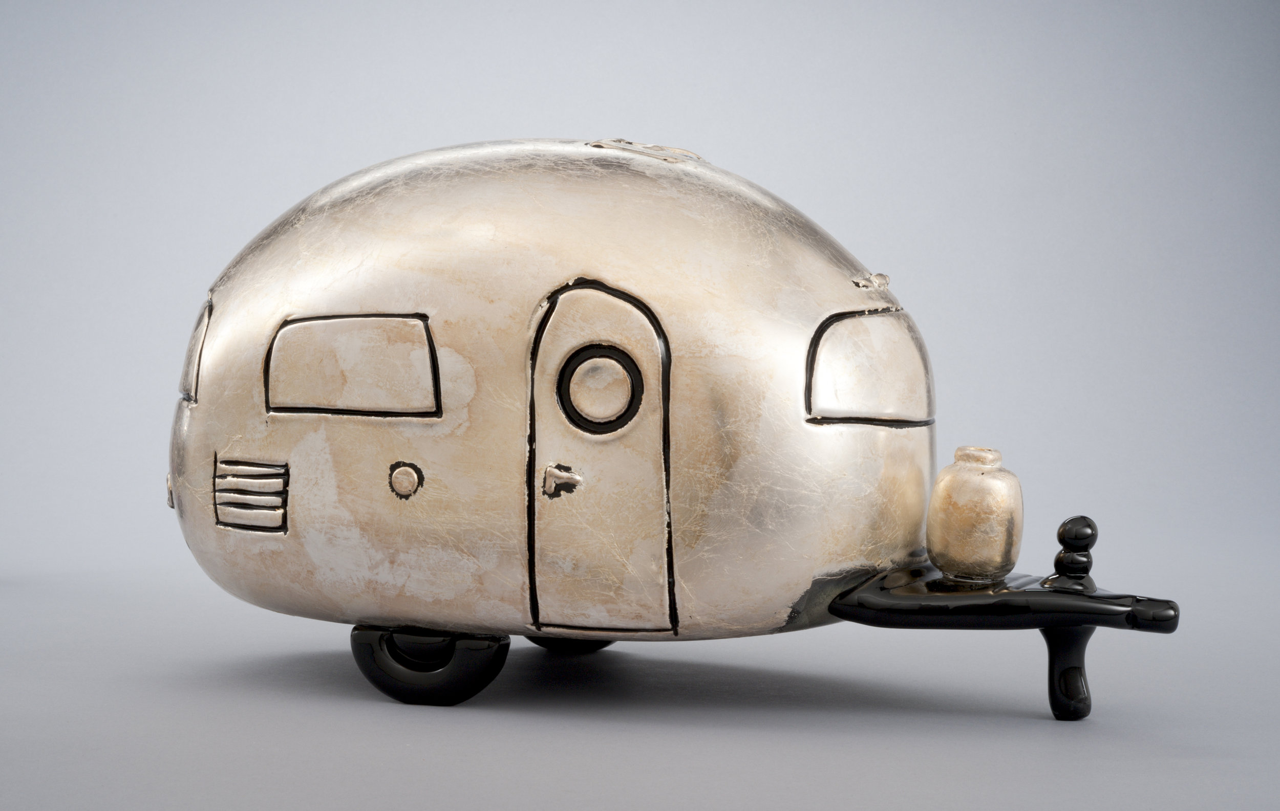 Alex Stisser (American, born 1974). Silver Loaf,  Made at the Museum in 2010.Blown glass and silver foil;8 1/2 x 17 x 7 3/4 in.Collection of Museum of Glass, Tacoma, Washington, gift of the artist.Photo by Duncan Price.