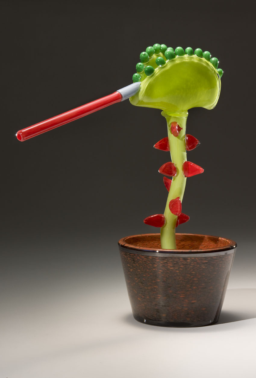 Designed by Benjamin Gruenbaum (age 9), made by Museum of Glass Hot Shop Team and Joseph Gregory Rossano (American, born 1962). Venus Flytrap with a light saber,  2008.Blown and hot-sculpted glass;17 x 16 x 7 in. Collection of Museum of Glass, Tacoma, Washington, sponsored by Mr. and Mrs. George H. Weyerhaeuser, Sr.Photo by Russell Johnson and Jeff Curtis.